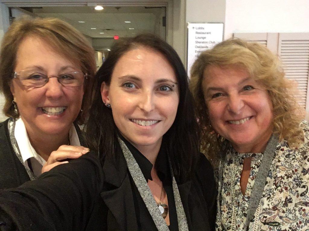 Three women smiling at camera