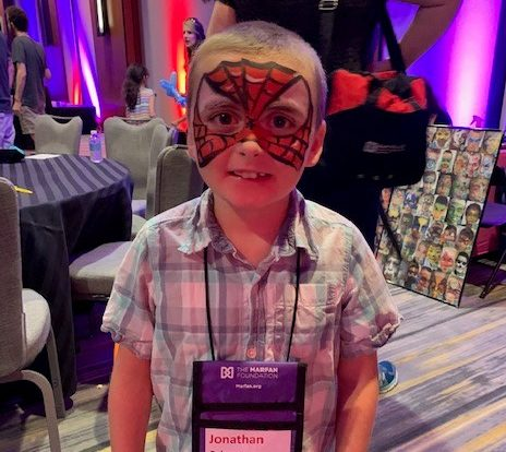 Young boy with vEDS with face painted like spiderman