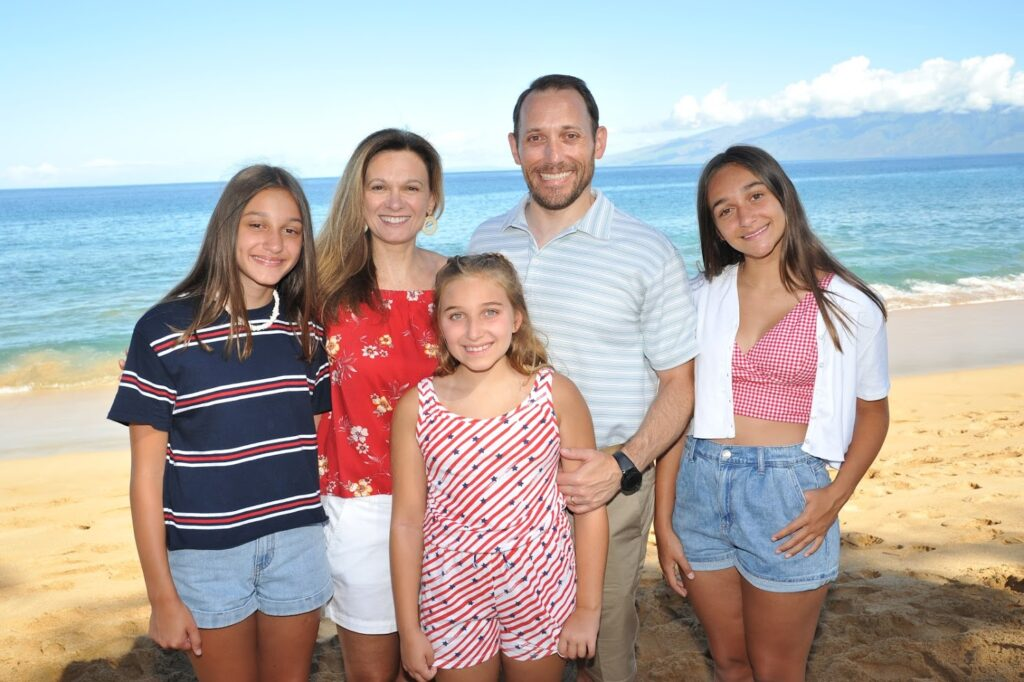 Dominick Corso, who has VEDS, and his family at the beach in Maui.